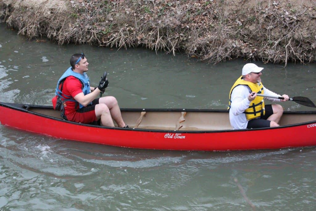 two Farmer EG consultants kayaking