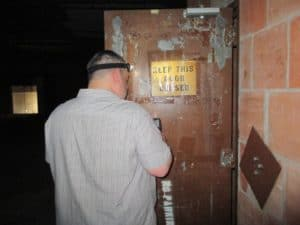 licensed inspector conducting a test in an old building